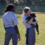 Middle School Student holding puppy