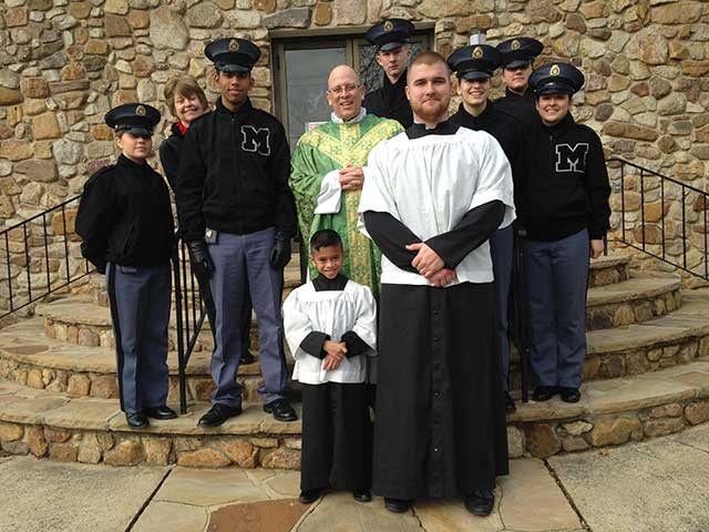 Cadet with catholic priest